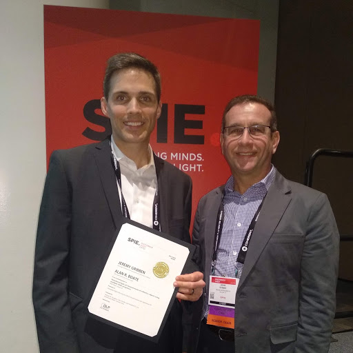Ajile CTO Jeremy Gribben accepting the award  for Best Paper at the conference for Emerging Digital Micromirror Device Based Systems and Applications XII from conference chair John Ehmke of  Texas Instruments DLP Products.
